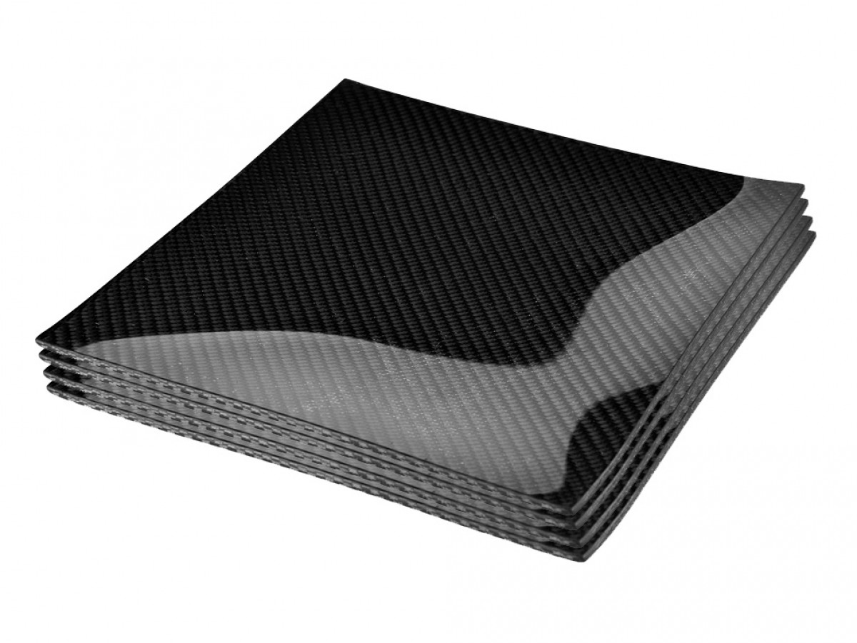 For the Gearhead Bachelor Who Has Everything: Carbon Fiber Place Settings
