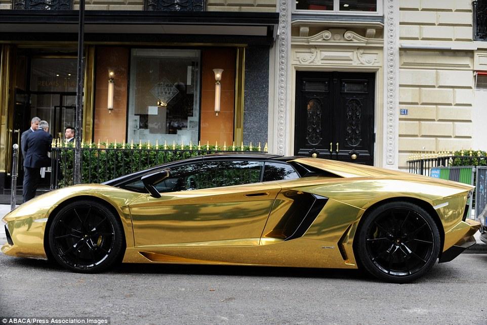 1411572510121_wps_69_A_gold_Lamborghini_Aventa
