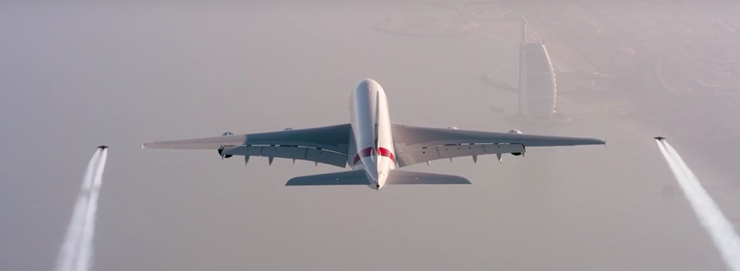 Watch These Crazy Guys In Jetpacks Fly Right Next to a Commercial Passenger Plane