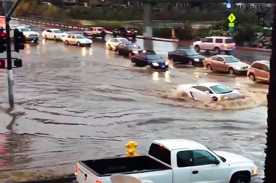 Think This Lamborghini Driver Can Make it Across This Flooded Road?