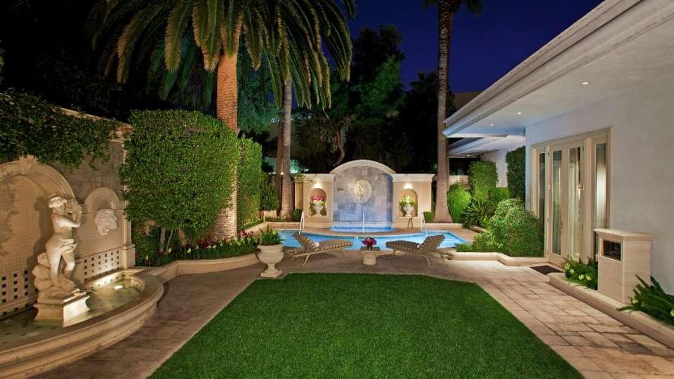mirage-villas-backyard-pool-exterior-night.tif.image.960.540.high